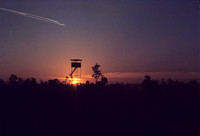 Along the watch tower on Christmas morning 1972, at Ramasen Thailand. The streaks in the sky are B-52 bombers returning from a mission over Hanoi and Hiapong.