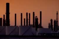 The refinery looks great with the sunset sky.