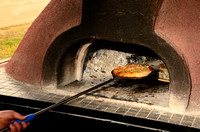 Hot and fresh oven fired pizza ready to be served.