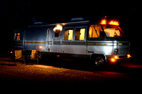 Night time scene with alll the lights at on the inside of a motorhome.
