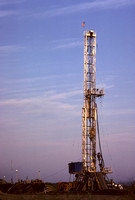 Drilling a shallow well with hope of striking gas.