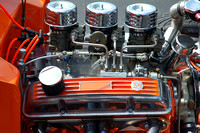 Power of a big block V8 with a six-pack for fuel supply.