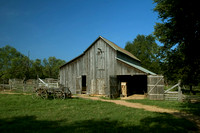 The Johnson Farm barnyard is a great view with country barn and wagon in the foreground.