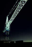 Construction crane  at night with with light.