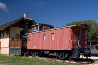 Kyle train museum with depot and caboose.