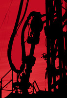 Silhouette view of the drill head on a drilling rig.